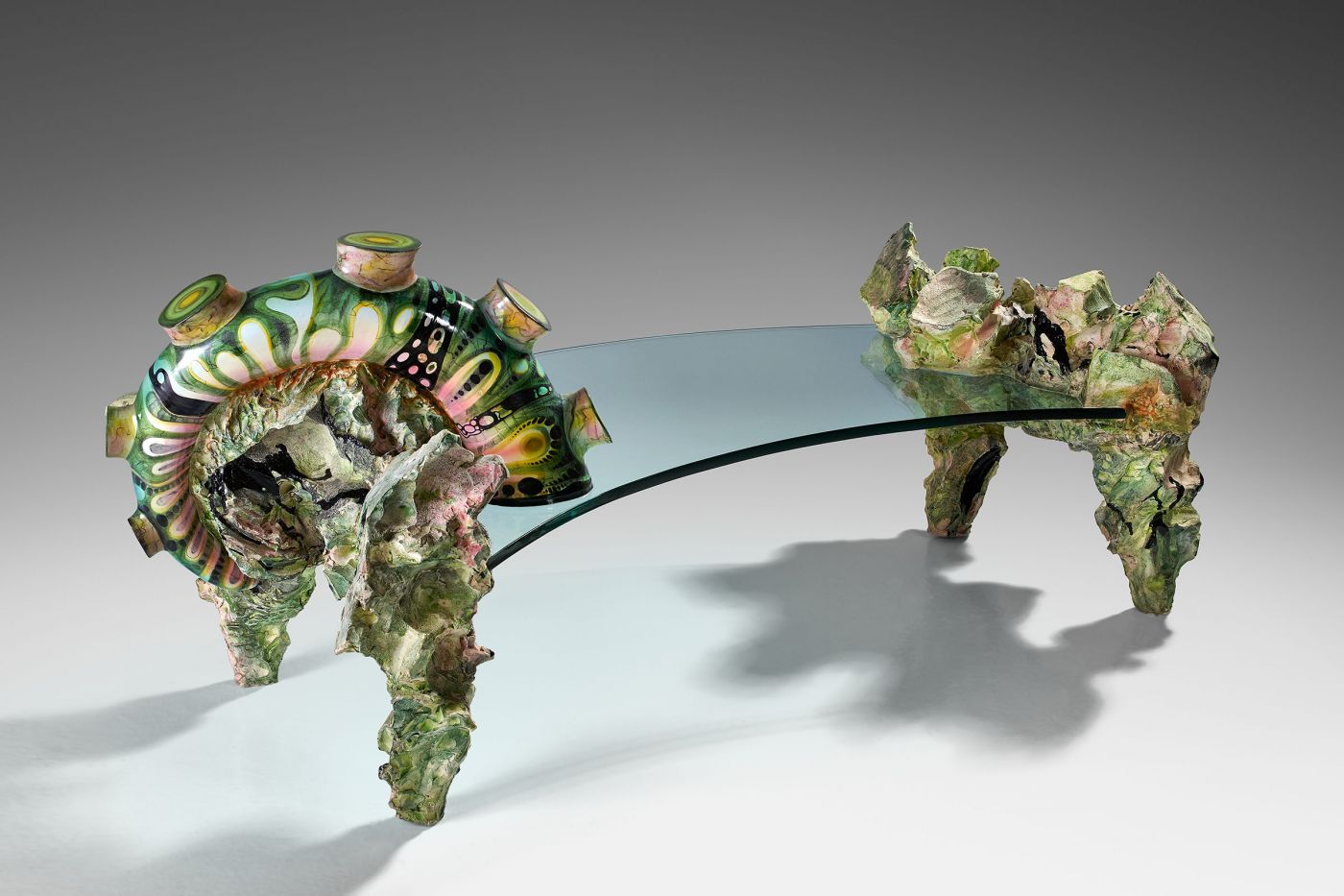BERTOZZI & CASONI, Tavolo roccioso, Enamelled and painted majolica, glass, 77 X 170 cm, 76 cm height, unique piece, dated and signed